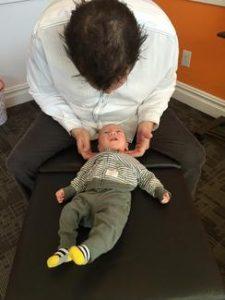 Dr. Josh Adjusting a Baby